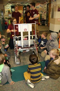 kids crowd around our robot