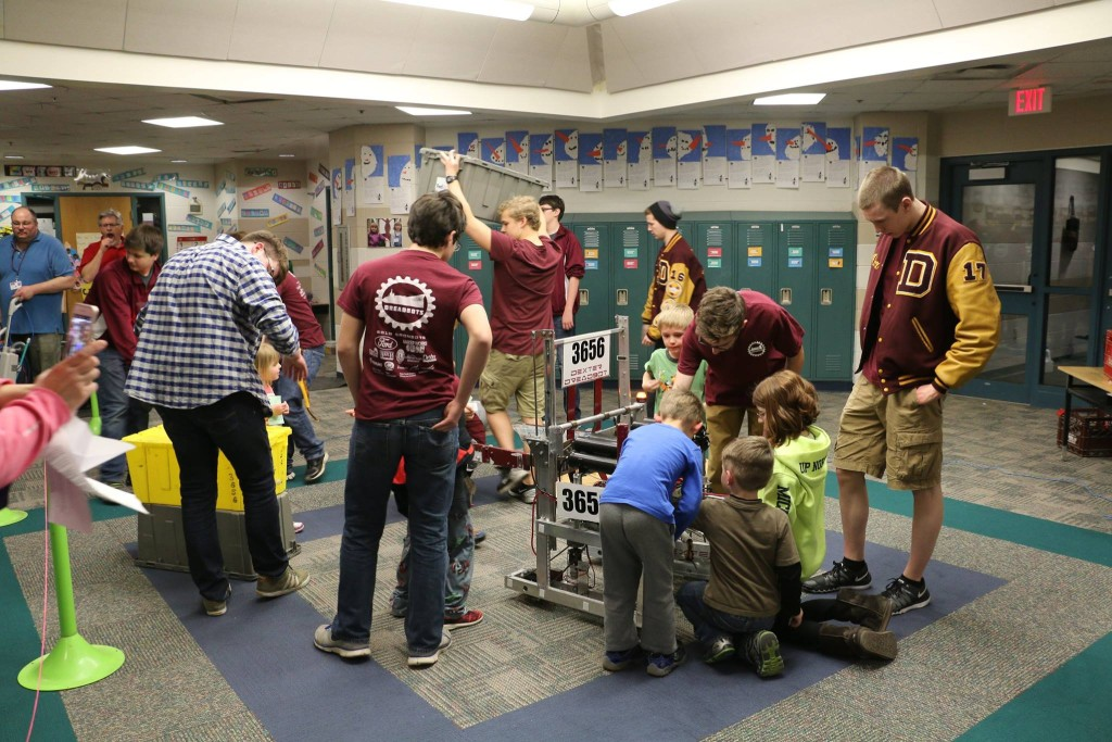 kids getting a close look at our robot