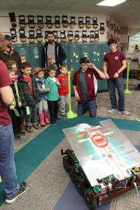 kids watch a our robot is driven