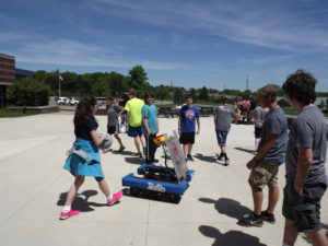 Robot outside with students