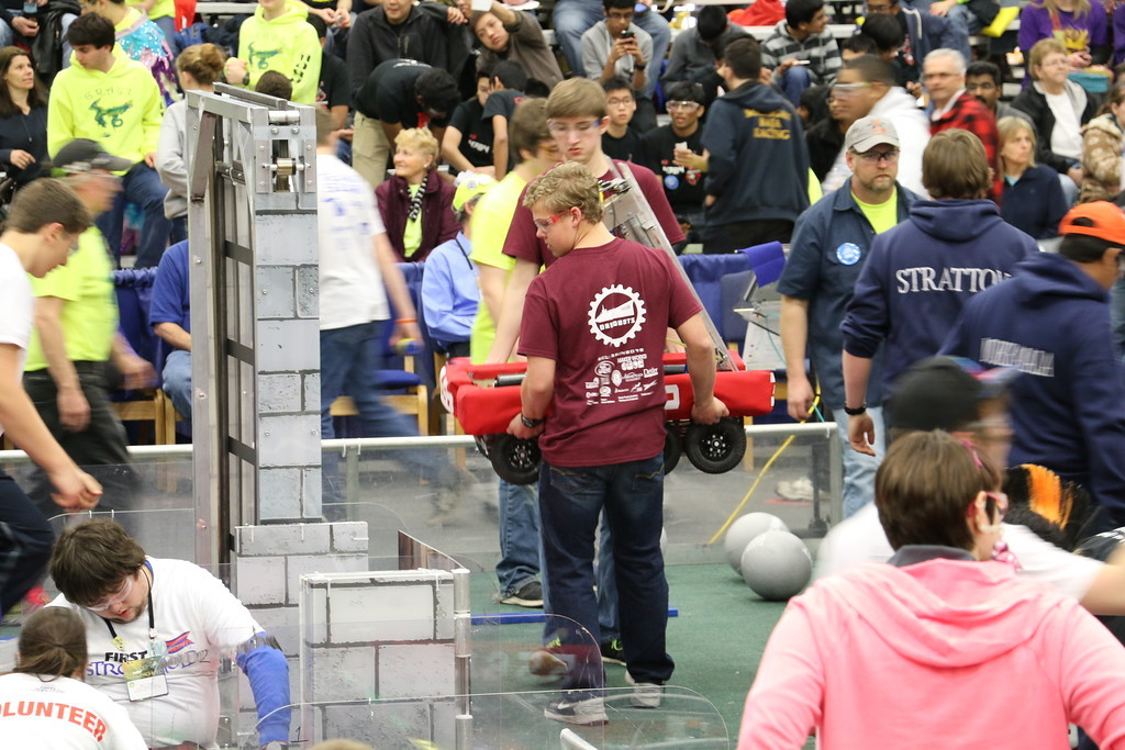 drive team carrying our robot