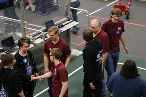 drive team shaking hands with other team