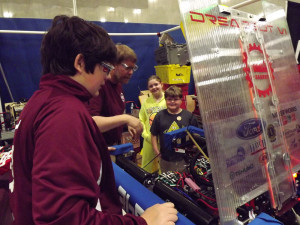 Two youngsters get a tour of our robot in the pit