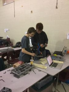 Spencer helping with a VEX robot