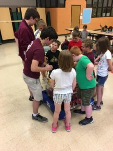 Campers gathered around our robot
