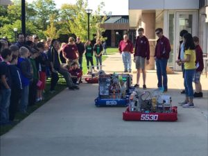 A crowd gathers to see the FRC robots in action.