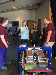 Genevieve and Cade show off our robot