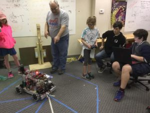 child drives robot while learning about it