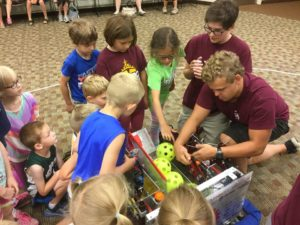 Kids getting hands-on with the robot