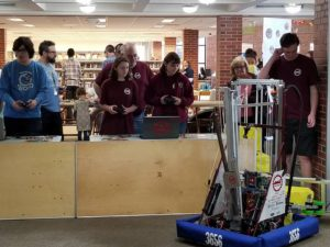 two female students driving our robot