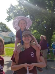 Sierra carries Lydia during the parade