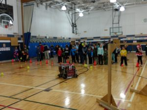 a crowd watches our robot pick up balls