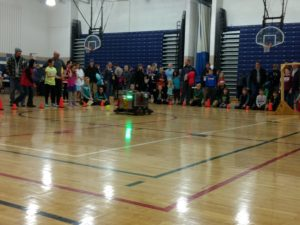 the robot playing catch with the kids