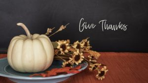 white pumpkin with 'give thanks'